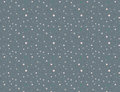 Seamless polka dot pattern on dark grey background