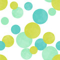 Seamless polka dots pattern in lime green blue