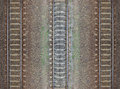 Seamless railroad pattern backdrop with space for text top view shiny iron rails and concrete sleepers coupled with powerful bolts Royalty Free Stock Image