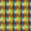 Seamless rainbow traingular pattern texture with gradient arrows in different colors blue green brown and yellow to red Royalty Free Stock Image