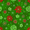 Seamless red flowerson green pattern. Royalty Free Stock Images