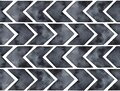 Seamless repeatable pattern of grunge dark black arrow signs with artistic brushstrokes, washes, stains and marks. Royalty Free Stock Photo