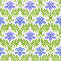 Seamless retro background with irises traditional ornaments сross stitch fancywork Royalty Free Stock Photo