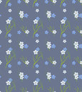 Seamless retro pattern of small flowers and grass blades Stock Photos