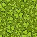 Seamless shamrock shapes green background Stock Photo