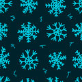 Seamless snowflakes and curls texture with blue negligent on the dark Stock Photography