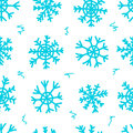 Seamless snowflakes and curls white texture with blue negligent on the Stock Images