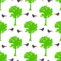 Seamless spring pattern with maple trees and birds Royalty Free Stock Photo