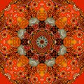 Seamless square pattern with bright flower - mandala in fiery tones. Royalty Free Stock Photo