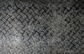 Seamless steel diamond plate texture, black and white rusty text Royalty Free Stock Photo