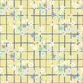 Seamless summer pattern with daisy silhouettes. Yellow chequered background and little multicolor flowers Royalty Free Stock Photo