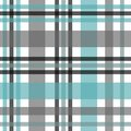 Seamless tartan plaid pattern. Checkered fabric texture print in stripes of bright blue, teal black, teal blue and white. Royalty Free Stock Photo