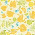 Seamless tea pattern with cups teapots and fruits Stock Images