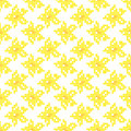 Seamless texture with abstract embroidered yellow flowers.