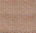 Seamless texture of a brick wall weathered finish beige decorative Royalty Free Stock Photos