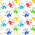 Seamless texture with colorful prints of child pal childrens hands Stock Image