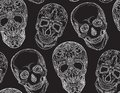 Seamless texture with a contour illustration of sugar skulls.