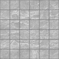 Seamless texture of grunge gray stone tiles wall with spots Royalty Free Stock Photo