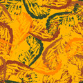 Seamless texture of leaves on orange background