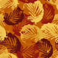 Seamless texture of leaves on warm background