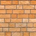 Seamless texture of orange grunge brickwall. 3d render