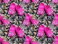 Pink children`s rubber slippers on pebbles Royalty Free Stock Photo