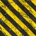 Seamless texture of warning stripes surface weathered in the yellow and black tileable Royalty Free Stock Image