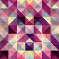 Seamless textured bright multicolored pattern of triangles with an optical effect Stock Photography
