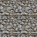 Seamless tile pattern of a stone wall Royalty Free Stock Photo