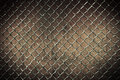 Seamless tileable chain link fence wall in background. Royalty Free Stock Photo