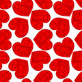 Seamless tribal red hearts background patterned with patterns inside tile Stock Image