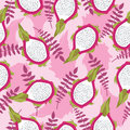 Seamless tropical pattern with fresh sliced dragon fruit and leaves on pink background. Abstract tasty fruit wallpaper.