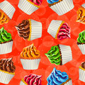Seamless vector background of cupcakes with cream on a orange Royalty Free Stock Photography