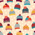 Seamless vector background knitted wool hats. Warm winter clothes wear pattern. Hand drawn cozy and warm accessories. Scandinavian
