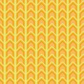 Seamless vector chevron pattern in yellow and orange colors