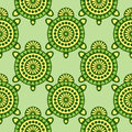 Seamless vector pattern with animals. Symmetrical background with closeup decorative turtles on the green backdrop Royalty Free Stock Photo