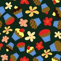 Seamless vector pattern with colorful cupcakes and flowers on dark background