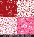 Seamless vector pattern with colorful hearts.