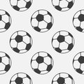 Seamless vector pattern, grey background with elements of black soccer balls Royalty Free Stock Photo