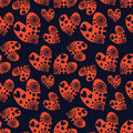 Seamless vector pattern with hearts. Background with red hand drawn ornamental symbols on the blue. Decorative repeating ornament.
