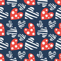 Seamless vector pattern with hearts. Background with red and white hand drawn ornamental symbols on the blue.