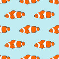 Seamless vector pattern with orange fishes on the blue background Royalty Free Stock Photo