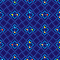 Seamless vector pattern with red, green, yellow and blue squares on blue background. Royalty Free Stock Photo