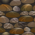 Seamless vector pattern with stones on dark background.
