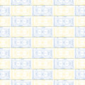 Seamless vector pattern. Symmetrical geometric background with blue and yellow squares on the white backdrop. Decorative ornament