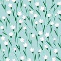 Seamless vector pattern with white snowdrop flowers.