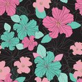 Seamless vector repeat colorful hibiscus flowers and leaf pattern on a black background.