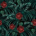 Seamless vector tropical pattern with green palm leaves and dark hibiscus flowers. Royalty Free Stock Photo