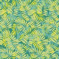 Seamless vector tropical pattern with overlapping palm leaves in yellow and teal green