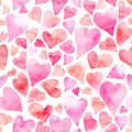 Seamless watercolor pattern with colorful hearts - romantic light and soft tints of pink and red.